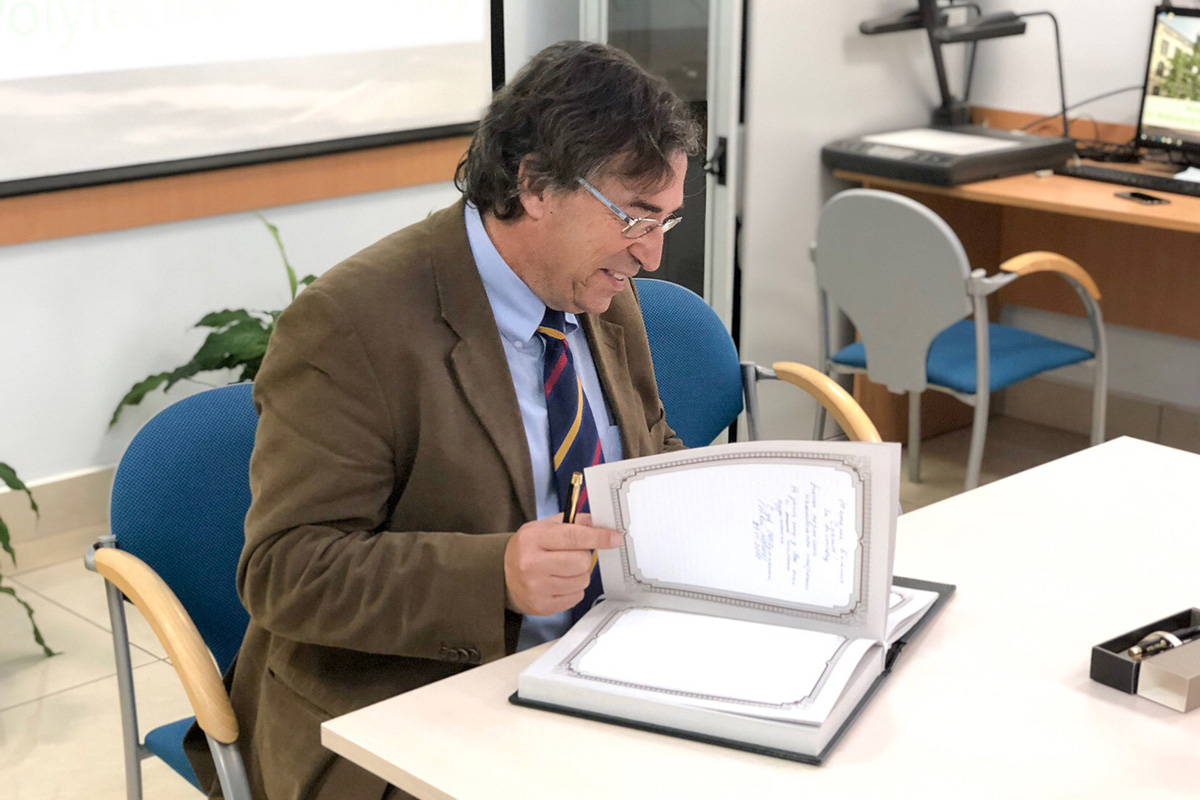 Vice-Rector for International Relations of BarcelonaTech Juan Jesus Perez signing the SPbPU Distinguished Visitors Book