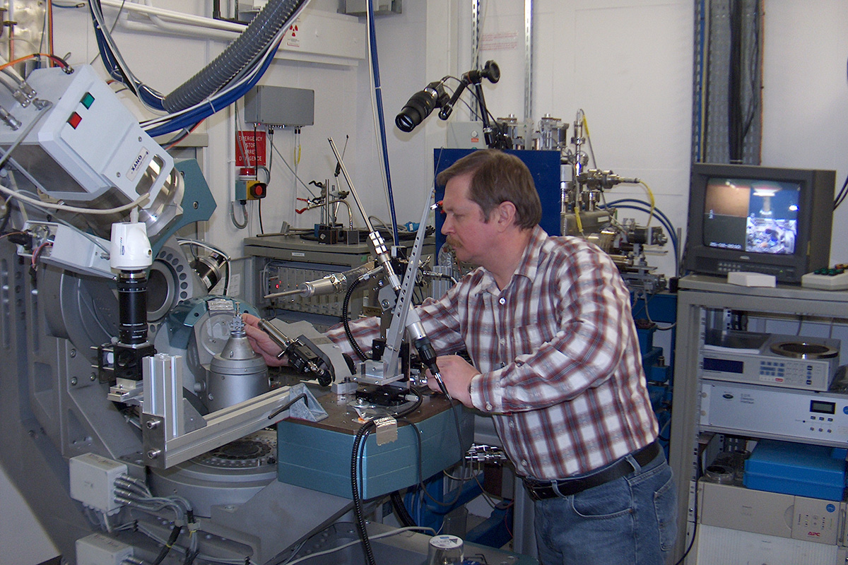 Alexey Filimonov studying the structure of the new alloy